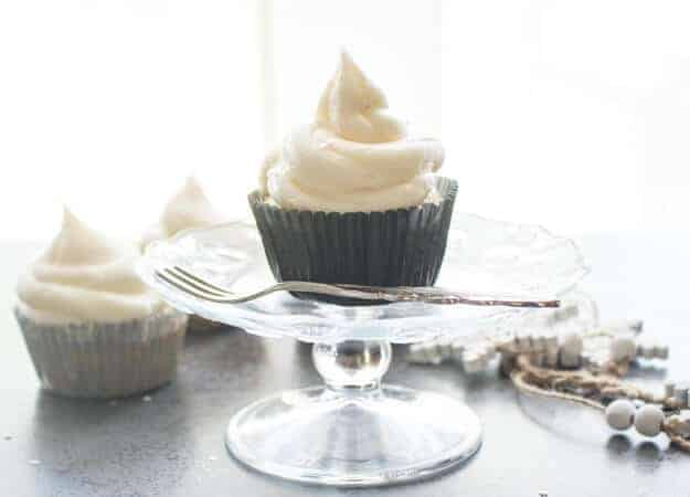 cupcake on a glass plate with a fork