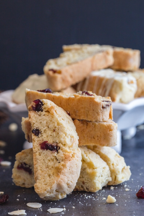 almond biscotti on a plate and one leaning on 3 stacked