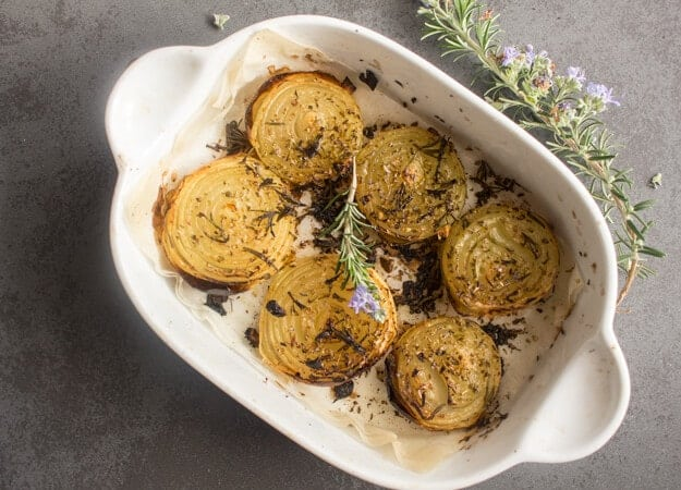 Rosemary Roasted Onions, whole roasted onions sprinkled with rosemary & spices and drizzled with olive oil. So yummy.