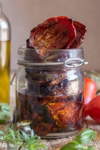 oven dried tomatoes in a jar with oil