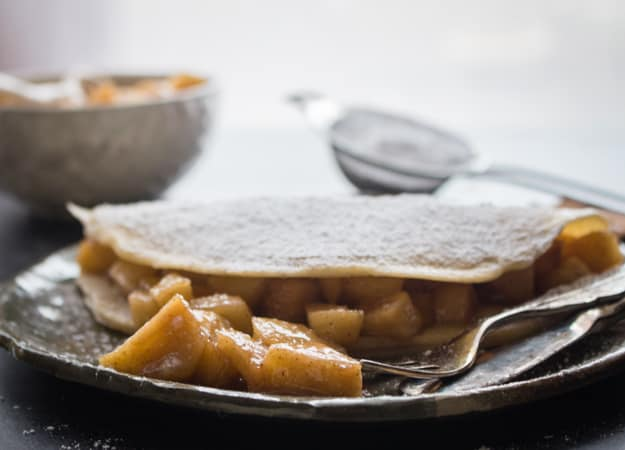 Homemade Apple Pie Cinnamon Crepes, the perfect recipe to end the winter season. A simple cinnamon crepe with a delicious Apple Pie filling. anitalianinmykitchen.com