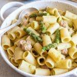 creamy asparagus pasta in a white baking dish