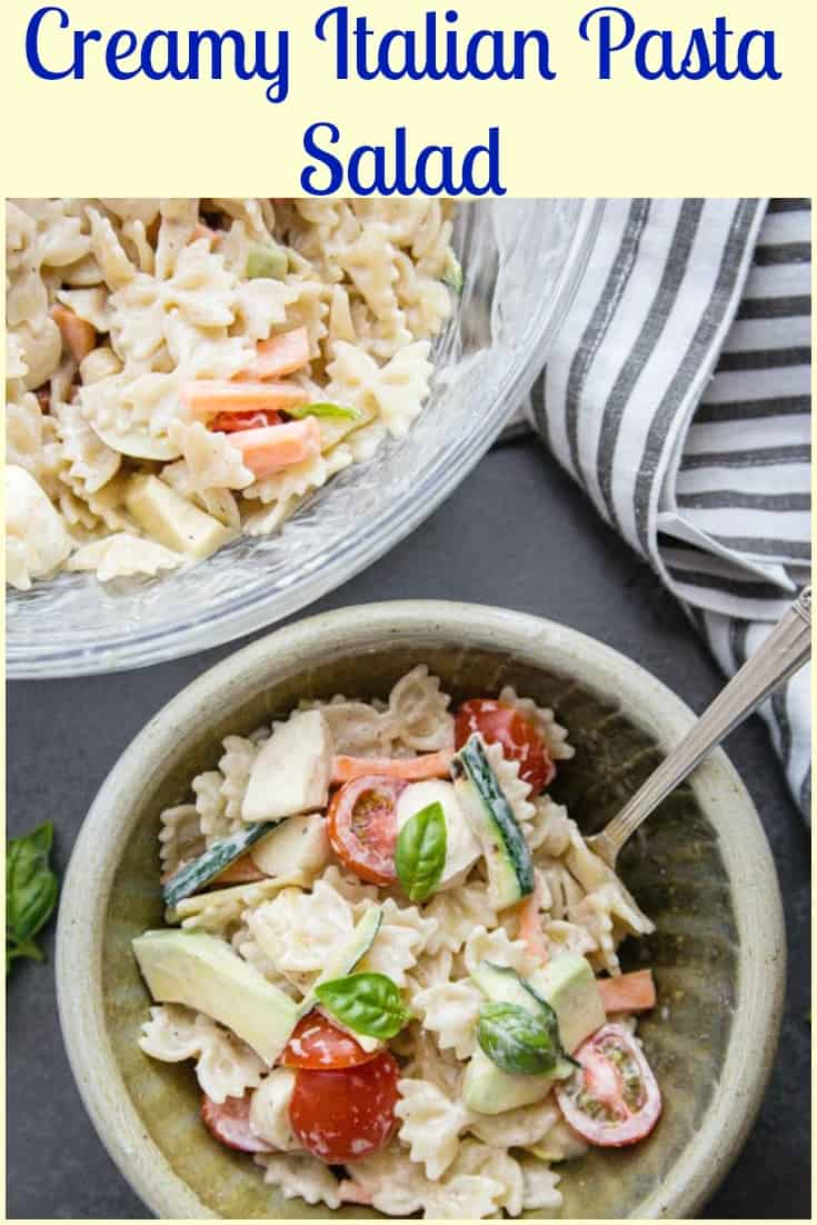 Creamy Italian Pasta Salad, the perfect Summer Pasta recipe made with fresh tomatoes, avocado, zucchini and herbs and a deliciously creamy Homemade Italian Dressing.  #pastasalad #creamyitaliandressing #salad #pasta #Italianrecipe