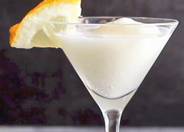 lemon sorbet drink with a slice of lemon on the rim