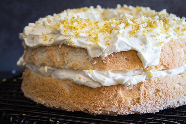 lemon tiramisu cake on a wire cake stand