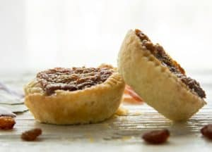2 old fashioned butter tarts, one leaning against the other