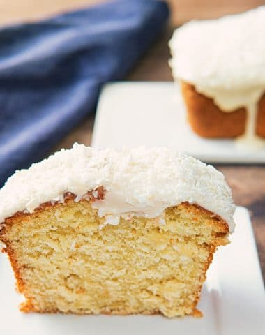 a slice of coconut pound cake on a white board