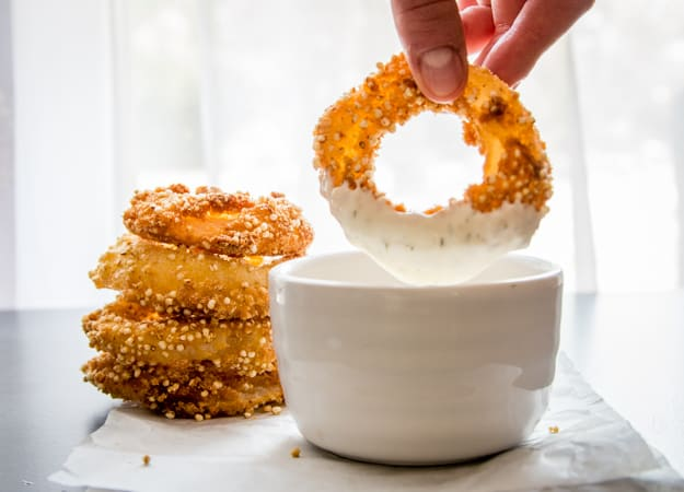 dipping a crispy crunchy onion ring in dip