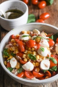 corn salad and dressing in bowls
