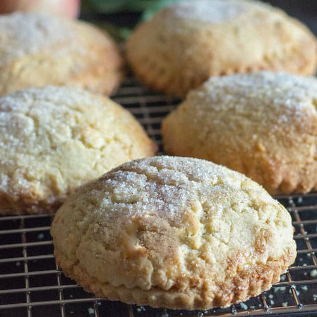 Apple pie cookies on a wire rack.