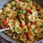 fresh grape tomato pasta close up in a pot