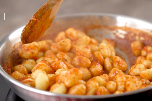 Gnocchi added to the sauce.