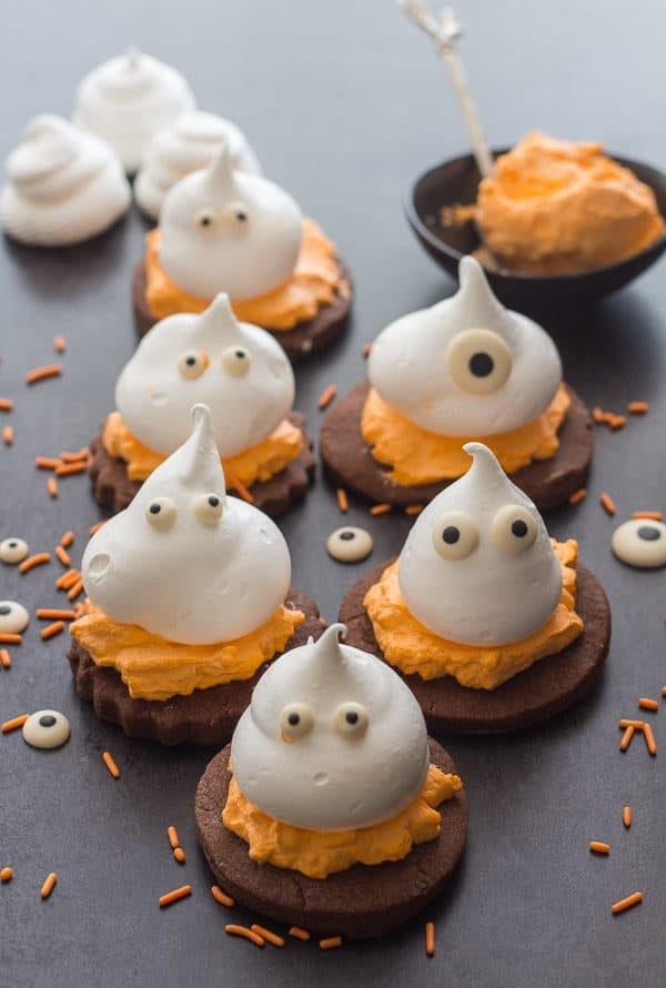 Meringue Ghost Chocolate Sugar Cookies, a delicious 3 layer Halloween treat, chocolate sugar cookie, a creamy filling and a meringue ghost.