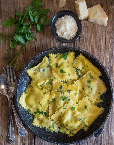Homemade Creamy Mushroom Ravioli, a homemade egg pasta recipe filled with a creamy mushroom filling. The perfect dinner idea.