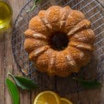 Orange Olive Oil Cake, a moist Italian Cake made with fresh oranges, olive oil and greek yogurt. A simple orange glaze makes it perfect.