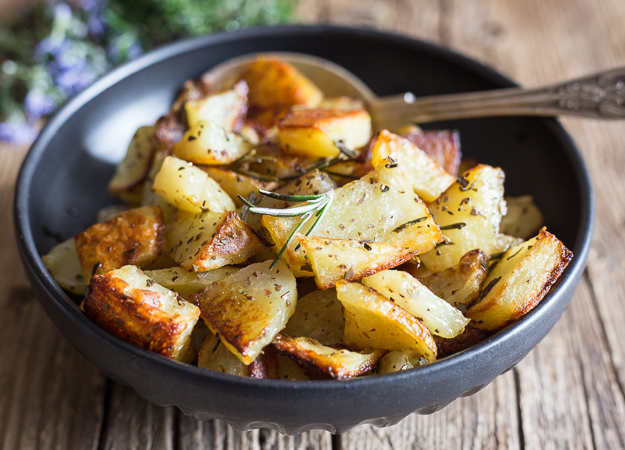 rosemary roasted potatoes in a black bowl