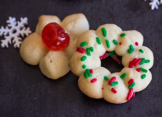 close up of 2 Italian spritz cookies