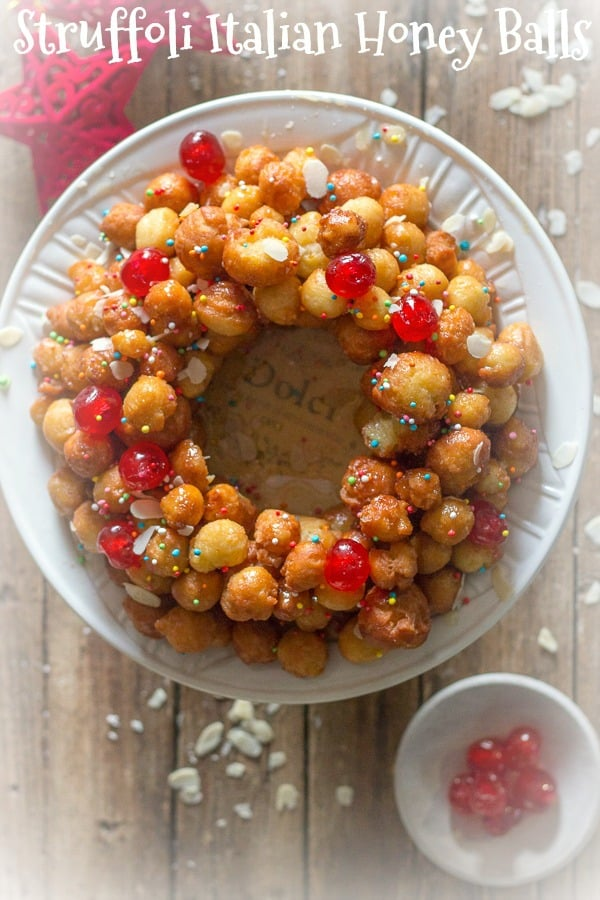 Struffoli Italian Honey Balls, delicious crunchy pastry balls covered in honey, a traditional Italian Christmas or Easter dessert recipe from Naples.  #Christmas #honey balls #Italian #pastry