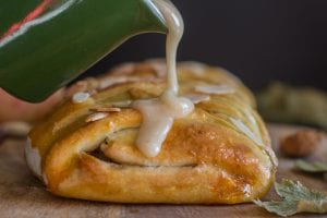 apple strudel with maple glaze being poured