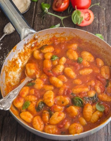 easy tomato sauce with gnocchi in a silver pan with a spoon