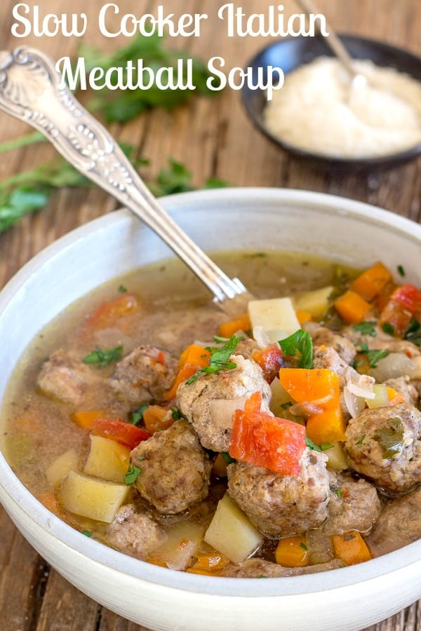 Italian Meatball Soup made in a slow cooker, a delicious comfort soup filled with lots of vegetables and mini meatballs. An easy tasty Italian spiced fall or winter soup. #soup #meatballs #Italian #comfort food #slow cooker #crock pot