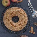 applesauce cake on a black board with whole apples
