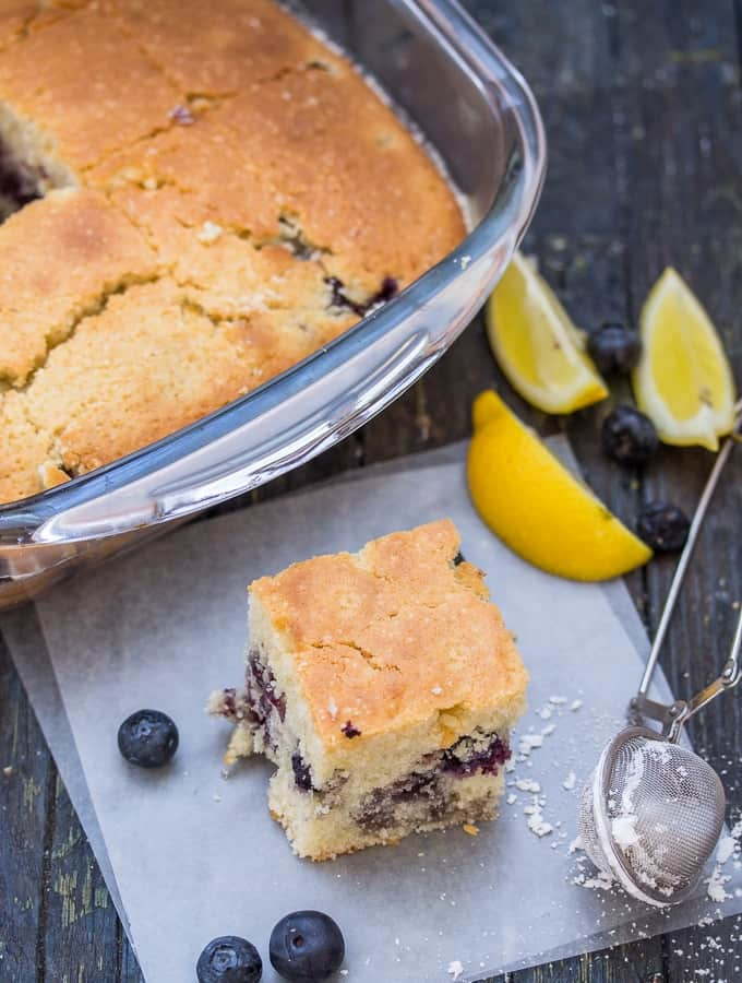 blueberry bars in the pan and one on the board