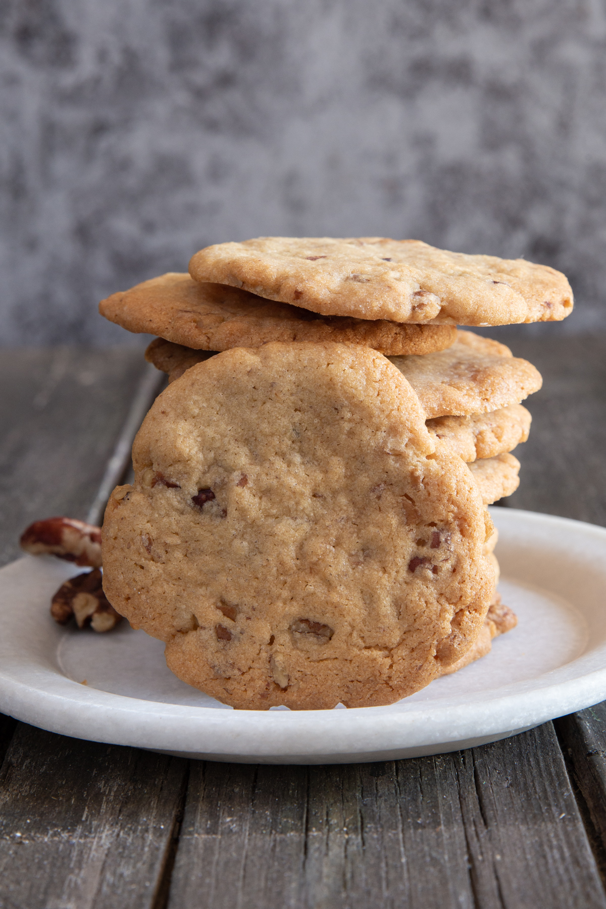 Stacked cookies with one leaning against them.