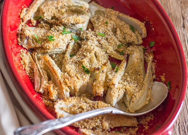 baked fennel gratin in a red pan