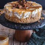 caramel cheesecake on a black cake stand