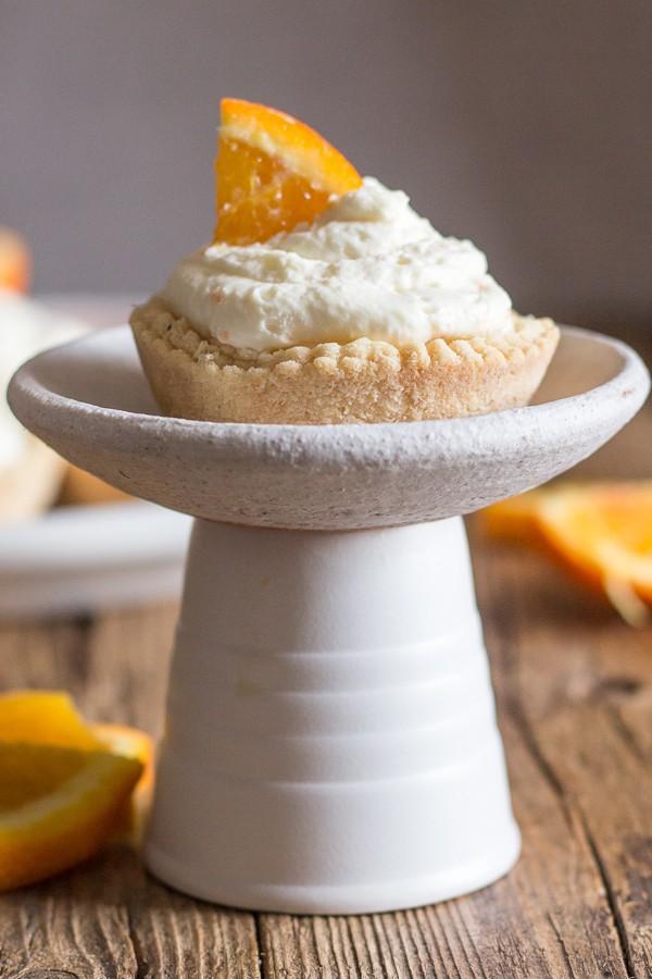 an orange cheesecake tart on a white plate