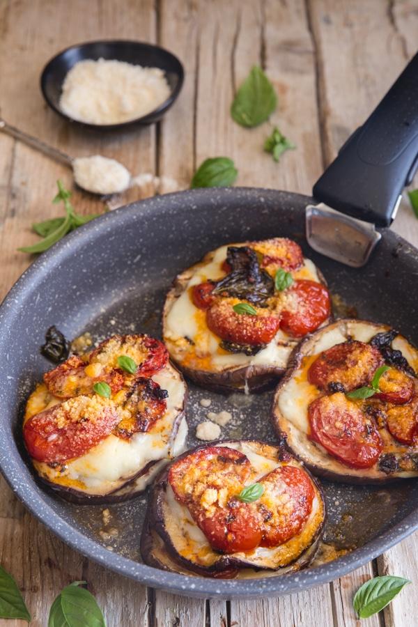 eggplant parmesan stacks in a black pan