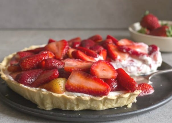 fresh strawberry pie with a cut sliced