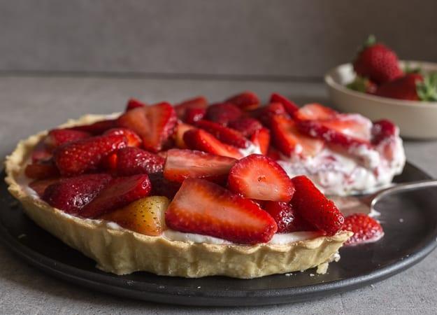 strawberry pie with a piece cut