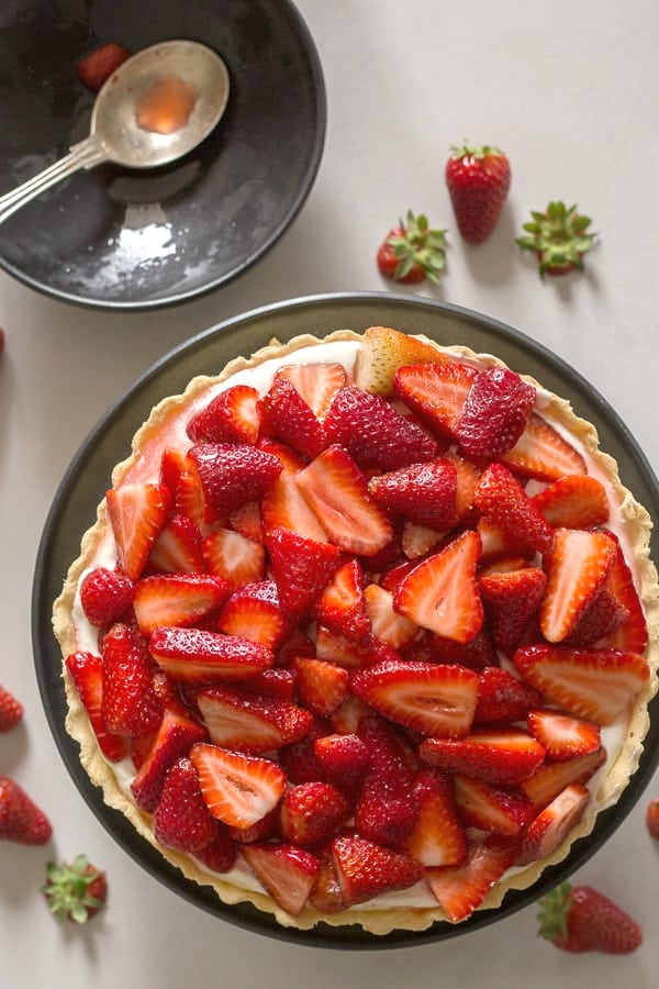 fresh strawberry pie on a black plate