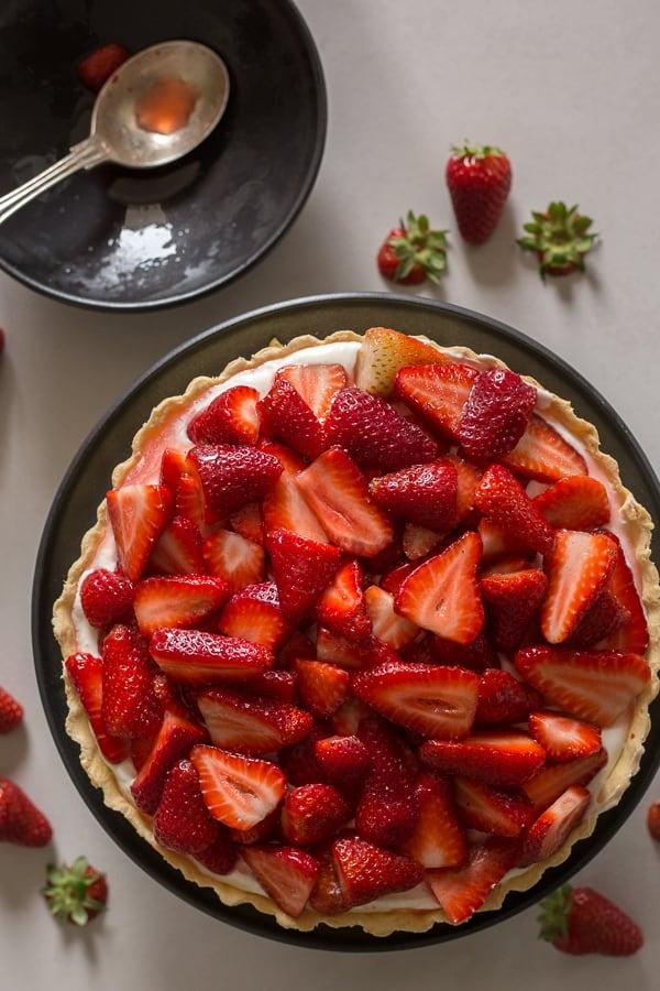 fresh strawberry pie on a black plate