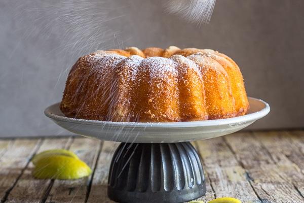 dusting powdered sugar on the tablespoon lemon cake