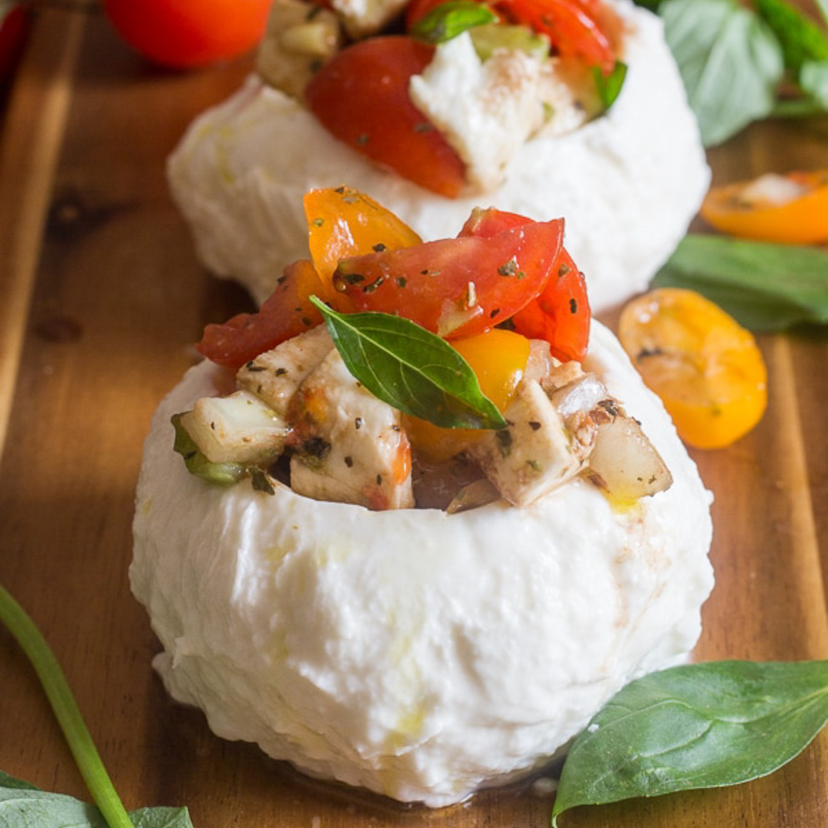 2 mozzarella stuffed with tomatoes & herbs.