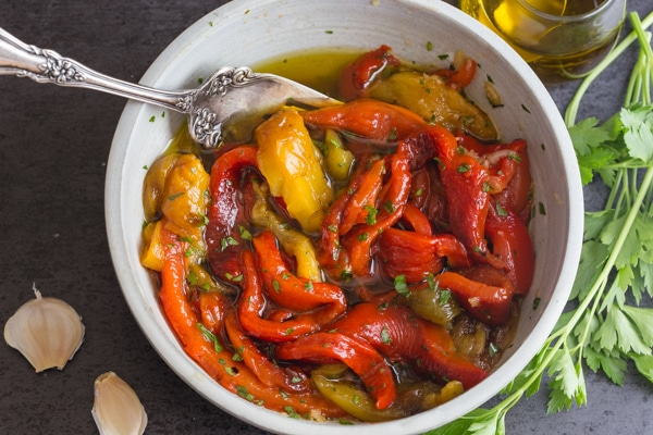 up close white bowl with roasted peppers