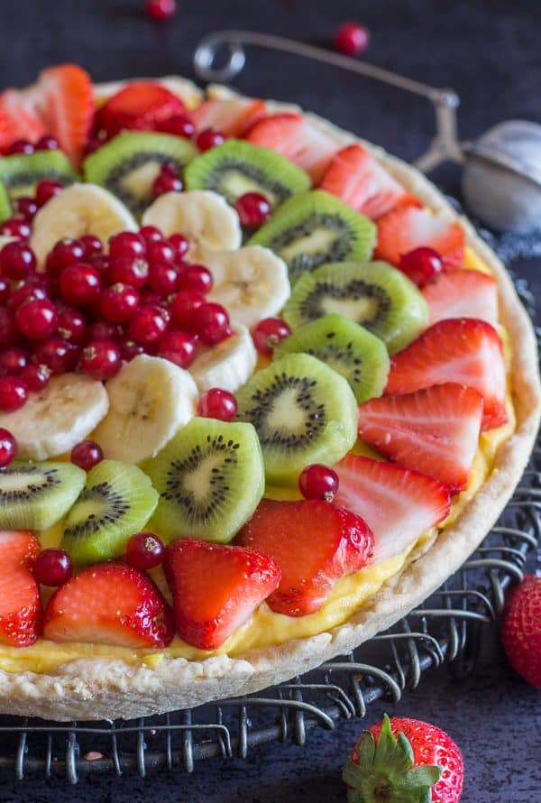 fruit pizza on a black board
