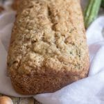 zucchini bread on a white cloth