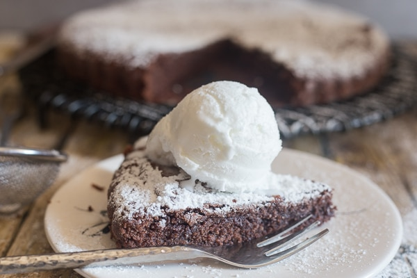 brownie cake slice on a white plate