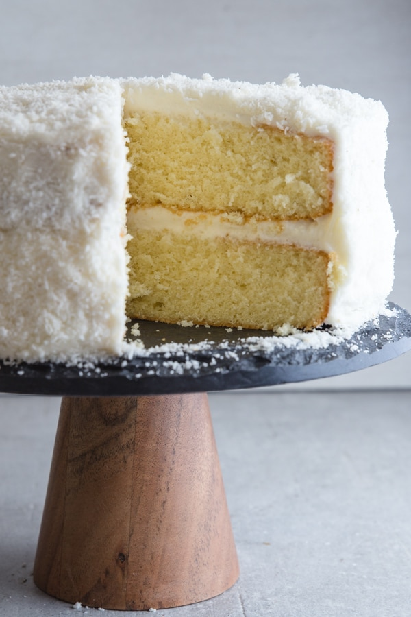 coconut layer cake with a slice out