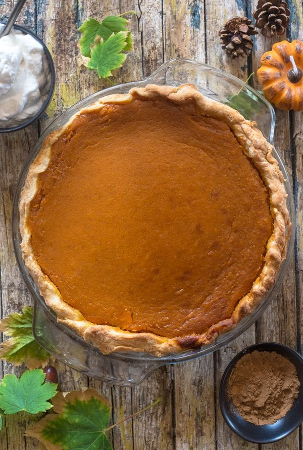 just baked pumpkin pie on a wooden board