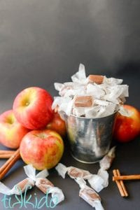 apple cider caramels in a tin