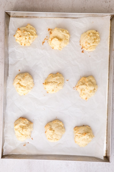 baked ricotta cookies on a baking sheet
