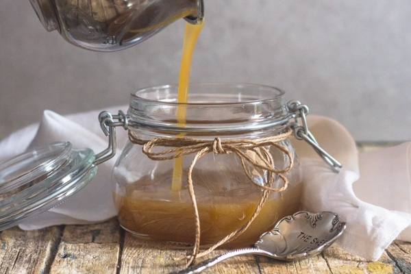 caramel sauce, pouring the finished sauce into a jar for cooling