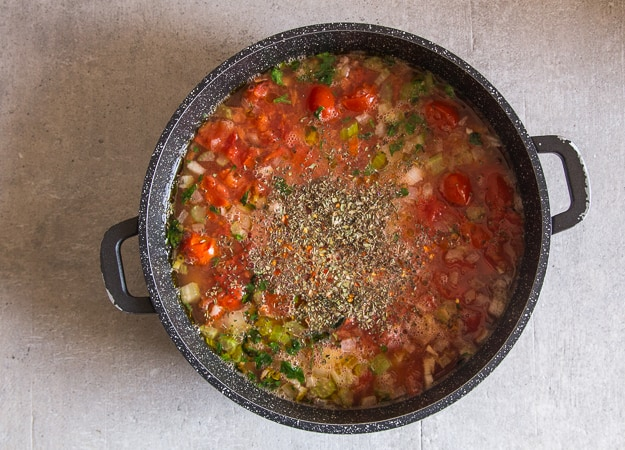 chickpea soup before cooked in a black pot
