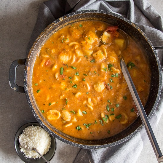 hearty chickpea soup in a black pot