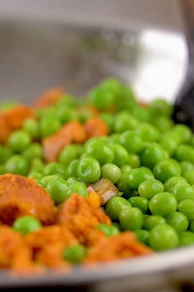 mixing the peas and sausage